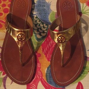 Tory Burch gold flip flops